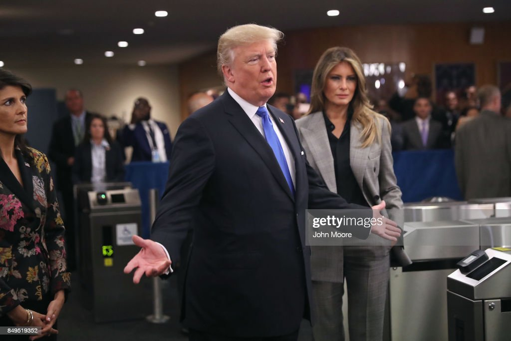 U.S. President Donald Trump stands with U.S. Ambassador to the United Nations Nikki Haley (L) and first lady Melania Trump upon arrival to the UN headquarters on September 19, 2017 in New York City. He addressed world leaders for the first time at the annual UN General Assembly meeting.