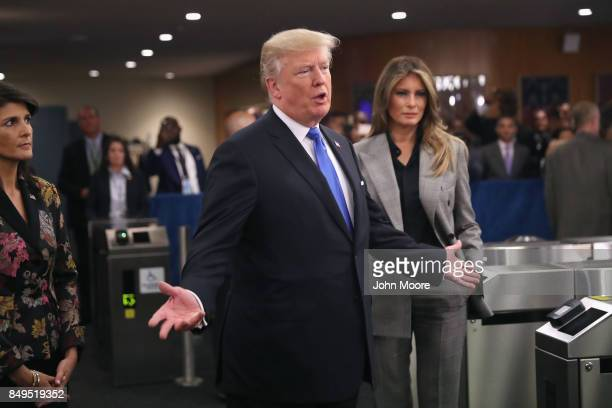 S President Donald Trump stands with US Ambassador to the United Nations Nikki Haley and first lady Melania Trump upon arrival to the UN headquarters...