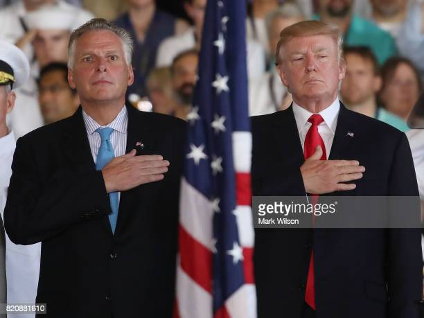 S President Donald Trump stands with Virginia Governor Terry McAuliffe during a commissioning ceremony on board the USS Gerald R Ford CVN 78 on July...