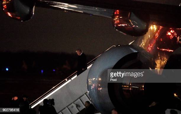 President Donald Trump steps off Air Force One after landing at Andrews Air Force Base in Maryland January 8 2018