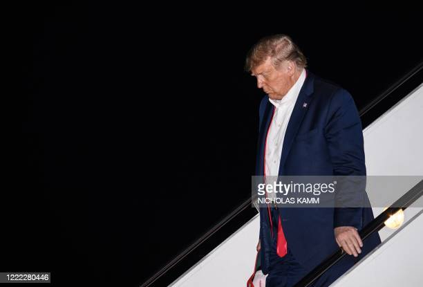 President Donald Trump steps off Air Force One at Andrews Air Force Base in Maryland on June 21, 2020 after returning from a rally in Tulsa, Oklahoma.