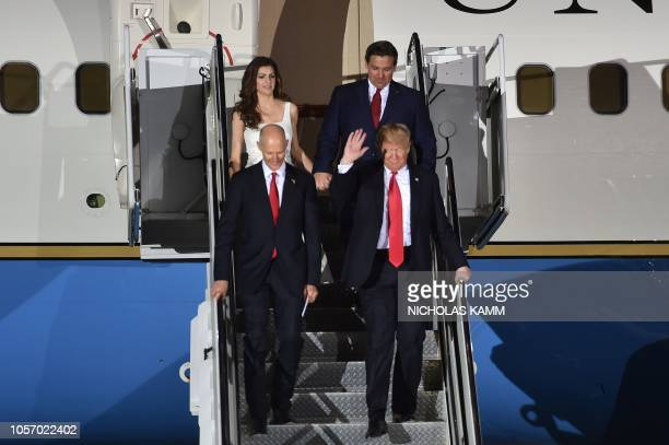 US President Donald Trump steps off Air Force One next to Governor of Florida Rick Scott US Representative and Republican nominee for Governor of...
