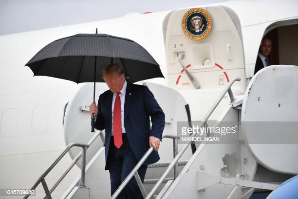 US President Donald Trump steps off Air Force One upon arrival at Rochester International Airport in Rochester Minnesota on October 4 2018