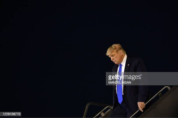 President Donald Trump steps off Air Force One upon arrival at McCarran International Airport in Las Vegas, Nevada on October 18, 2020.