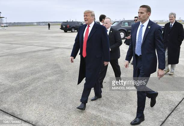 US President Donald Trump steps off Air Force One upon arrival at Louis Armstrong New Orleans International Airport in Kenner Louisiana on January 14...