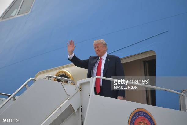 US President Donald Trump steps off Air Force One upon arrival at Marine Corps Air Station Miramar in San Diego California on March 13 2018 / AFP...