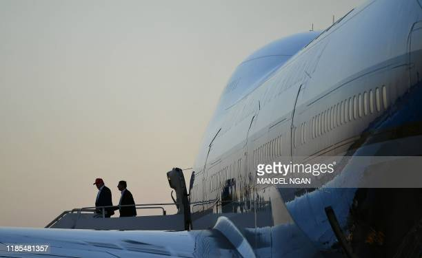 US President Donald Trump steps off Air Force One upon arrival at Palm Beach International Airport with Senator John Barrasso RWY in West Palm Beach...