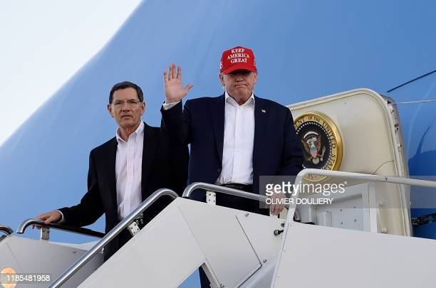 US President Donald Trump steps off Air Force One upon arrival at Palm Beach International Airport in West Palm Beach Florida on November 29 2019...