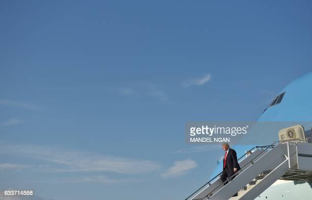 US President Donald Trump steps off Air Force One upon arrival at Palm Beach International Airport in West Palm Beach Florida on February 3 2017 /...
