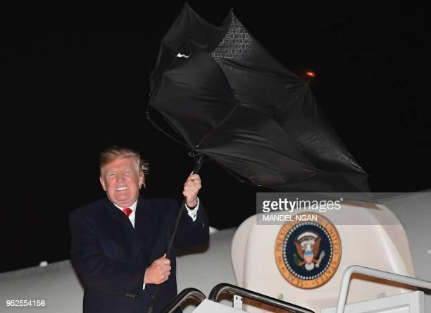 US President Donald Trump steps off Air Force One upon return to Andrews Air Force Base in Maryland on April 28 2018 Trump returned to Washington DC...
