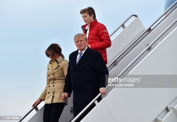 US President Donald Trump steps off Air Force One with first lady Melania and son Barron at Andrews Air Force Base in Maryland following the weekend...