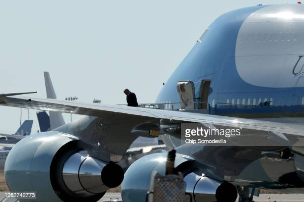 President Donald Trump steps off of Air Force 1 as he arrives for a campaign rally at Phoenix Goodyear Airport October 28, 2020 in Goodyear, Arizona....