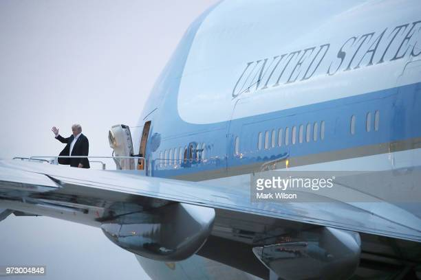 S President Donald Trump steps off of Air Force One at Joint Base Andrews after returning from a summit in Singapore with North Korean leader Kim...