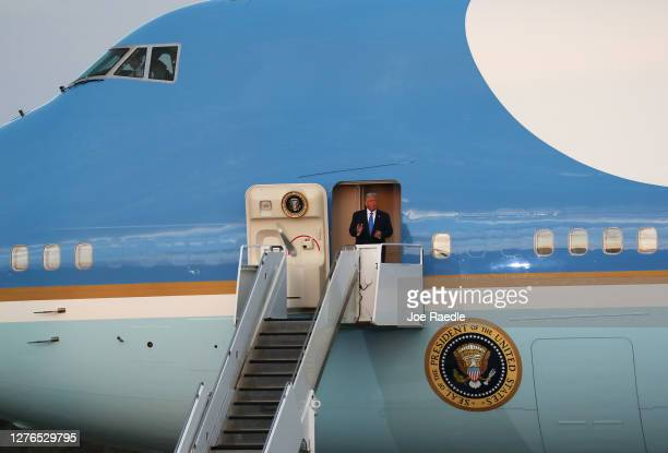 President Donald Trump steps out from Air Force One as he arrives for his, 'The Great American Comeback Rally', at Cecil Airport on September 24,...