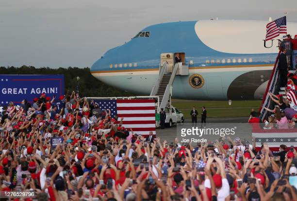 President Donald Trump steps out from Air Force One as he arrives for his 'The Great American Comeback Rally' at Cecil Airport on September 24 2020...