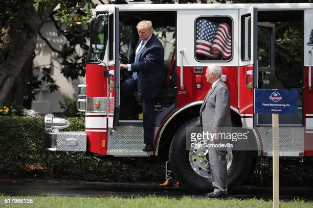S President Donald Trump steps out of a fire engine made by Pierce Manufacturing while touring a Made in America product showcase with Vice President...