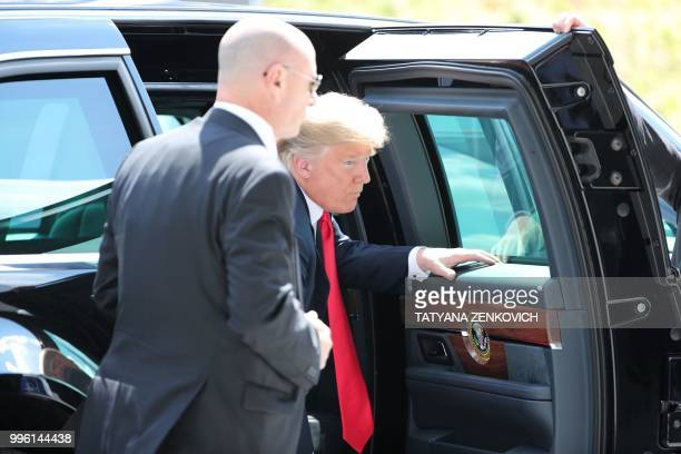 US President Donald Trump steps out of the US official state car also known as The Beast as he arrives to attend the NATO summit in Brussels on July...