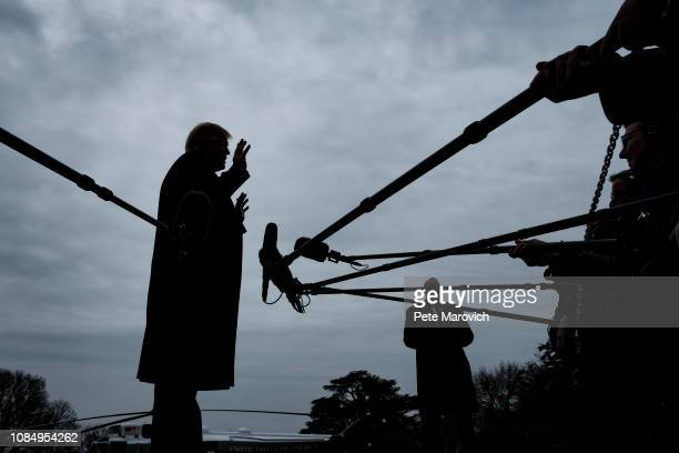 S President Donald Trump stops to speak to reporters as he prepared to board Marine One on the South Lawn of the White House on January 19 2019 in...