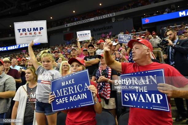 US President Donald Trump supporters cheer during a campaign rally at Ford Center in Evansville Indiana on August 30 2018