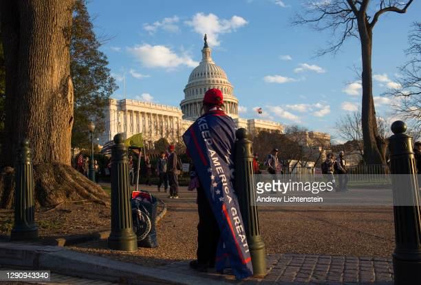 President Donald Trump supporters demonstrating against the election results march to the Supreme Court to protest against the Court's decision not...