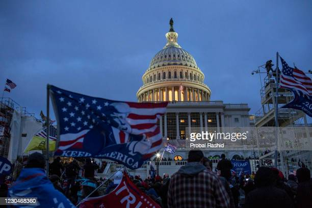 President Donald Trump supporters gather outside the Capitol building. Pro-Trump rioters stormed the US Capitol as lawmakers were set to sign off...