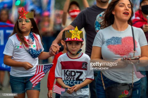 President Donald Trump supporters rally on Halloween during the last weekend before the presidential election day in Beverly Hills, California, on...