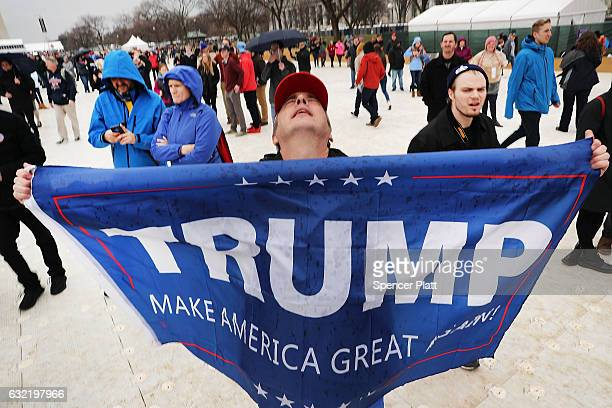President Donald Trump supporters react on the National Mall to the inauguration of US President Donald Trump on January 20 2017 in Washington DC...