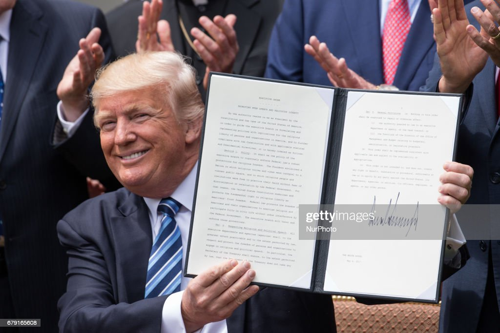 President Donald Trump, surrounded my members of the clergy, signed the Executive Order on Promoting Free Speech and Religious Liberty, in the Rose Garden of the White House, On Thursday, May 4, 2017.