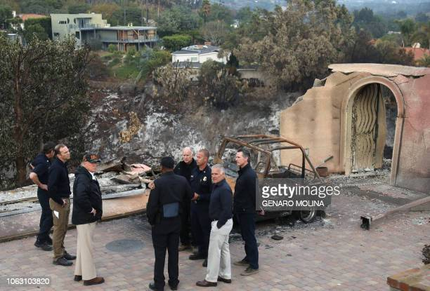 President Donald Trump surveys the damage from the Woolsey fire in Malibu on November 17 2018