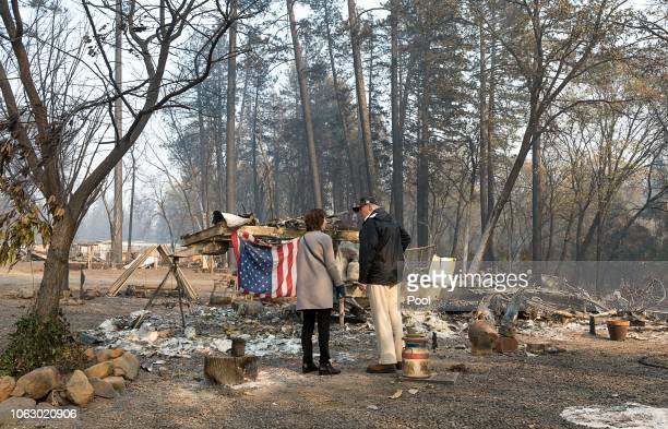 President Donald Trump surveys the damage with Paradise Mayor Jody Jones as they tour the Skyway Villa Mobile Home and RV Park during his visit of...