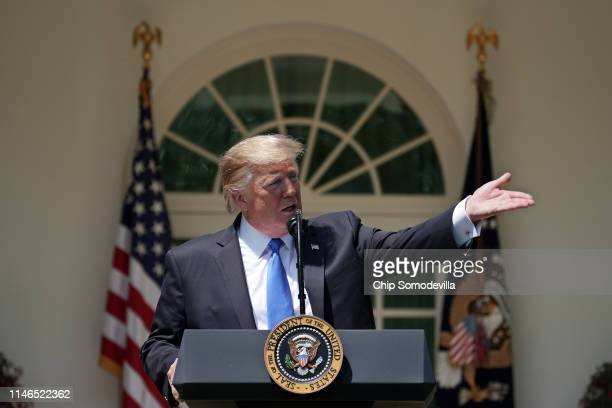 S President Donald Trump swats at a bee during a National Day of Prayer service in the Rose Garden at the White House May 02 2019 in Washington DC...