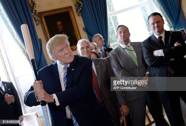 President Donald Trump swings a Marucci baseball bat in the Blue Room during a Made in America product showcase event at the White House in...