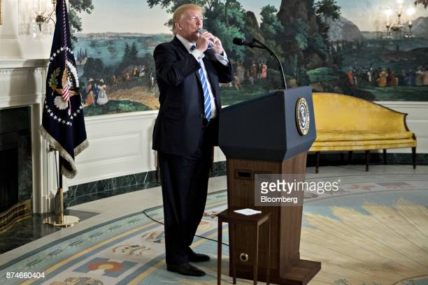US President Donald Trump takes a drink of water while delivering remarks on his recent 11day Asia trip in the Diplomatic Room of the White House in...