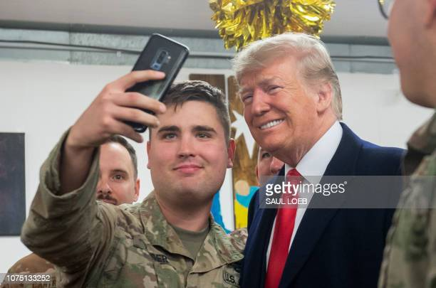 US President Donald Trump takes a photo as he greets members of the US military during an unannounced trip to Al Asad Air Base in Iraq on December 26...