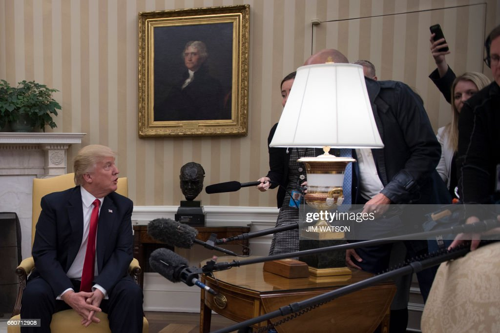 US President Donald Trump takes a question from the Danish press during a meeting with Danish Prime Minister Lars Lokke Rasmussen at the White House in Washington, DC, March 30, 2017. /