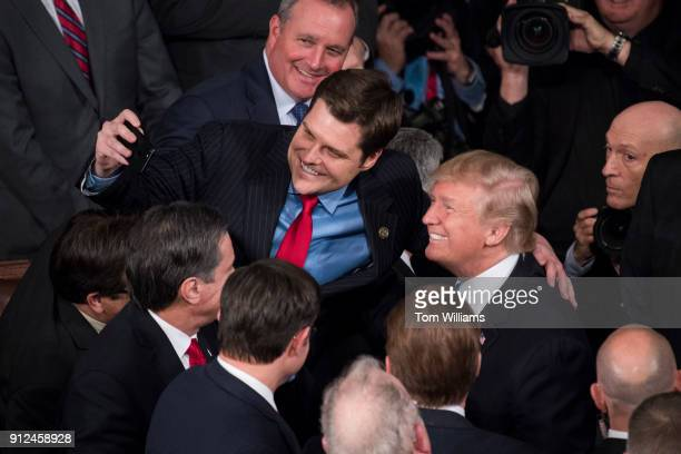 President Donald Trump takes a selfie with Rep Matt Gaetz RFla in the House chamber after Trump's State of the Union address to a joint session of...