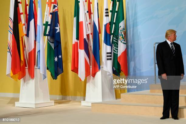 President Donald Trump takes his place for the family photo on the first day of the G20 summit in Hamburg northern Germany on July 7 2017 Leaders of...