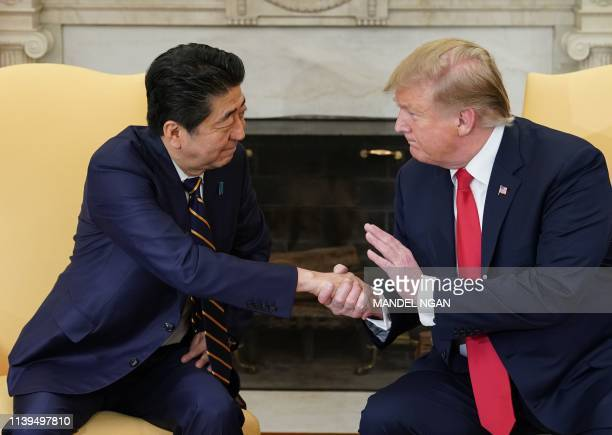 President Donald Trump takes part in a bilateral meeting with Japan's Prime Minister Shinzo Abe in the Oval Office of the White House in Washington...