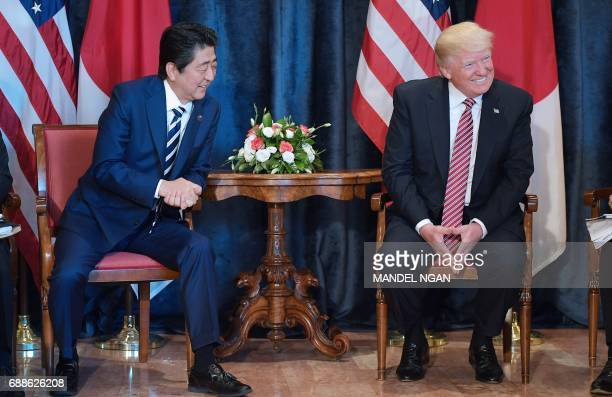 US President Donald Trump takes part in a bilateral meeting with Japan's Prime Minister Shinzo Abe at the Villa Diodoro on the sidelines of the...