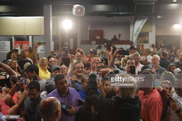 US President Donald Trump takes part in a food and supply distribution at the Cavalry Chapel in Guaynabo Puerto Rico on October 3 2017 Nearly two...