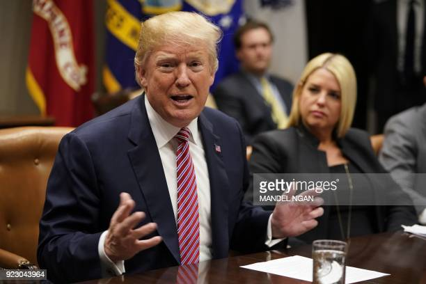 US President Donald Trump takes part in a listening session on gun violence with teachers and students in the State Dining Room of the White House on...
