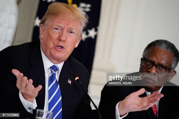President Donald Trump takes part in a meeting on infrastructure with state and local officials in the State Dining Room of the White House on...