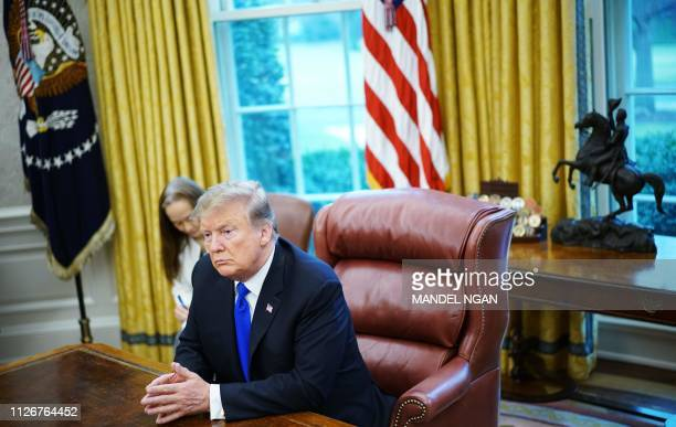 President Donald Trump takes part in a meeting with China's Vice Premier Liu He in the Oval Office of the White House in Washington, DC on February...