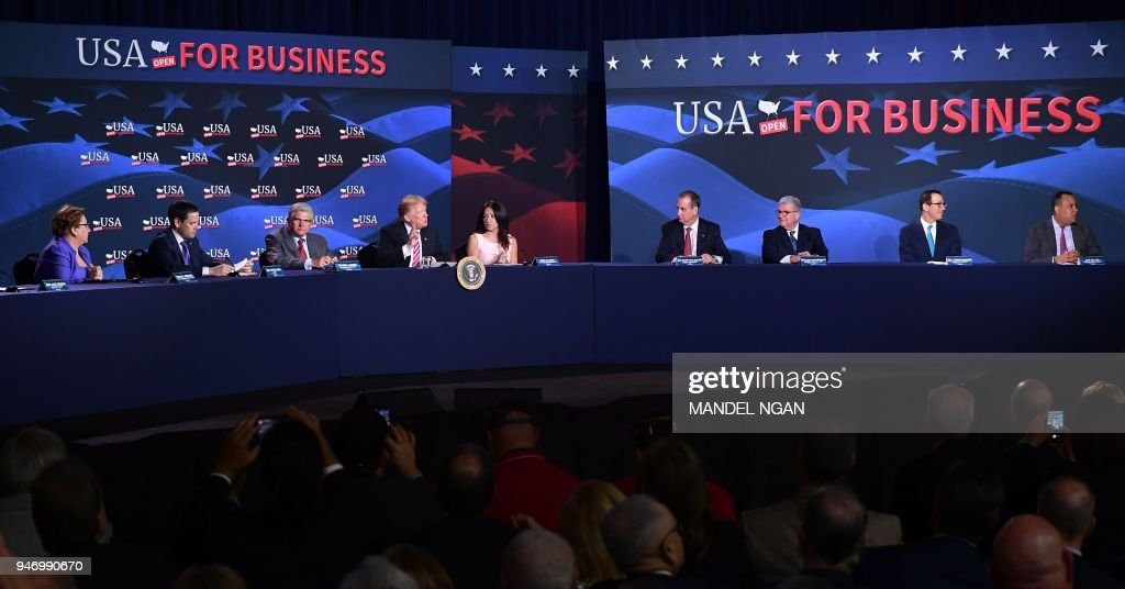 US President Donald Trump (4th L) takes part in a roundtable discussion on tax reform at Bucky Dent Park in Hialeah, Florida, on April 16, 2018. /