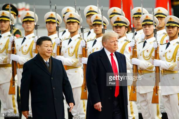 President Donald Trump takes part in a welcoming ceremony with China's President Xi Jinping on November 9, 2017 in Beijing, China. Trump is on a...