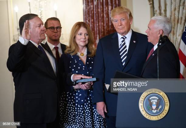 President Donald Trump takes part in the ceremonial swearing-in of US Secretary of State Mike Pompeo at the State Department on May 2, 2018 in...
