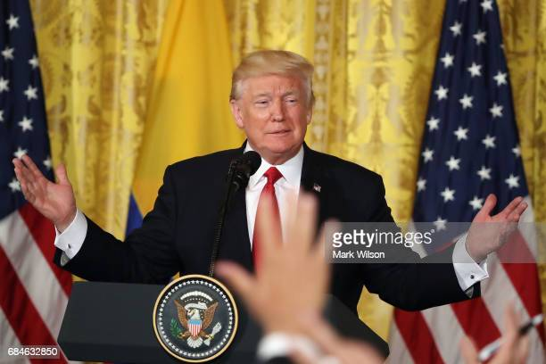 S President Donald Trump takes questions from reporters during a joint news conference with Colombian President Juan Manuel Santos at the White House...