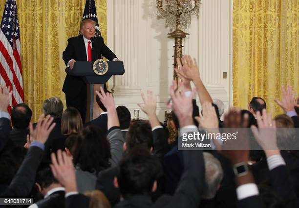 S President Donald Trump takes questions from reporters during a news conference announcing Alexander Acosta as the new Labor Secretary nominee in...