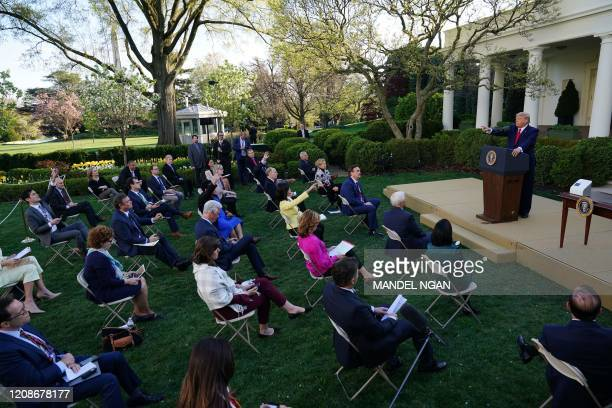 President Donald Trump takes questions from reporters during a Coronavirus Task Force press briefing in the Rose Garden of the White House in...