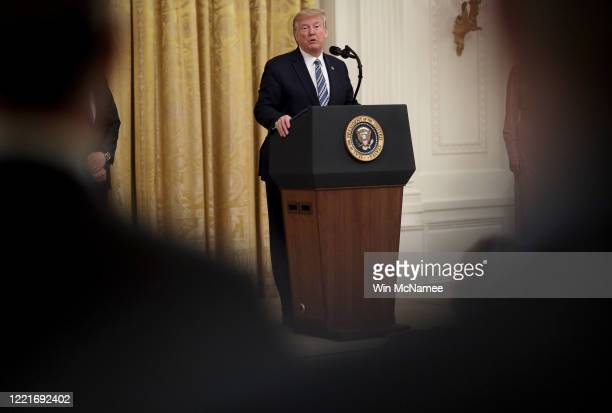President Donald Trump takes questions from reporters during an event on supporting small businesses through the Paycheck Protection Program in the...